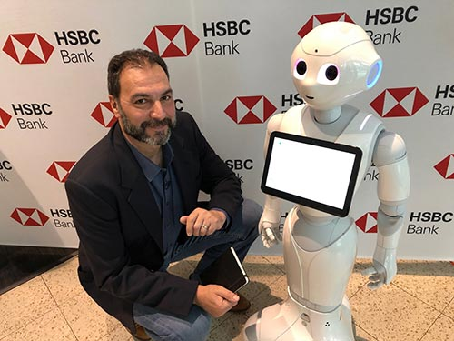 """Artificially intelligent robots and other """"thinking"""" machines are entering the workforce in health care, banking and retail. They can not only help you with your health, finances and store purchases, but offer a great investment opportunity too."""