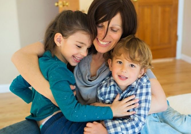 Mila, with her mother Julia Vitarello and 5-year-old brother. Photo courtesy of Mila's Miracle Foundation, MIT's Technology Review.