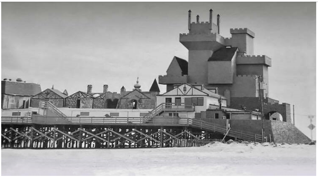 Historical photo of the Brigantine Castle, black and white, on the beach.